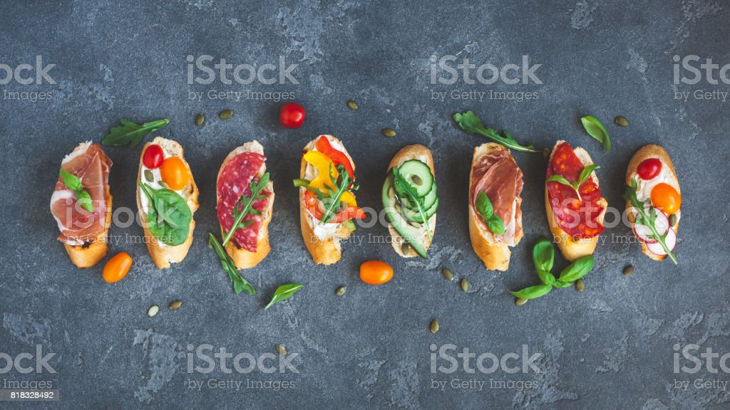 Traditional spanish tapas on dark background. Flat lay, top view - foto stock