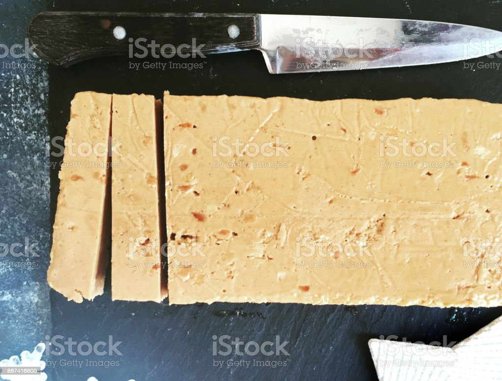 Traditional Spanish Turron and knife stock photo