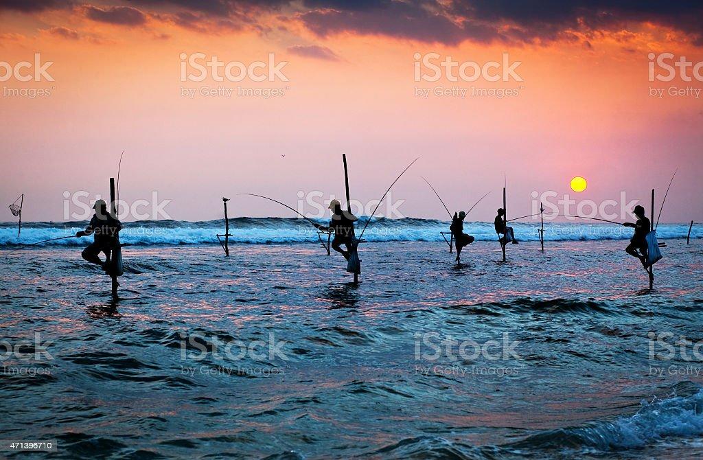 traditional stilt fishermen at the sunset nea stock photo