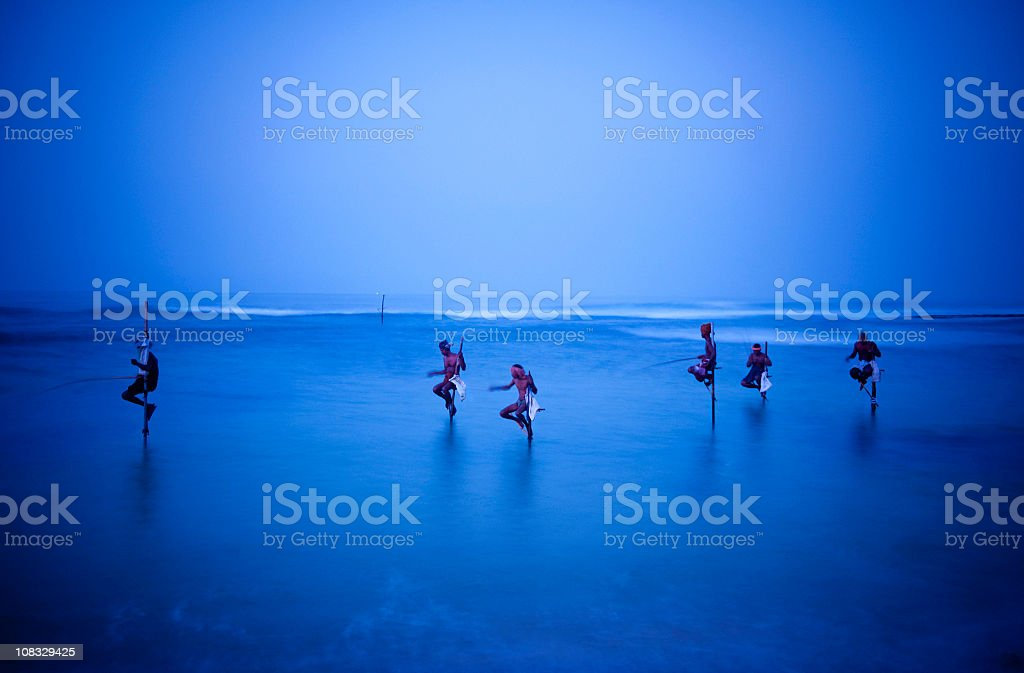Traditional stilt Fishermen stock photo