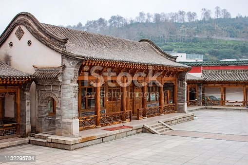 Traditional Stone And Wooden Chinese Architecture Of One Storie House. Courtyard Of A Renovated Oriental Brick Building. Carved Details Of Timber.