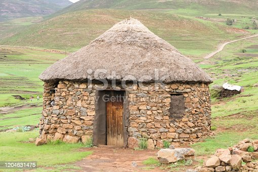 traditional stone bungalow with straw roof without people at Semonkong village and it's waterfall and Morija and it's Dinosaur footprints, Lesotho
