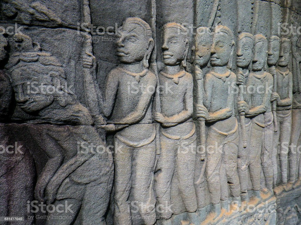 Traditional Stone Carving of Several People Angkor Thom Cambodia stock photo