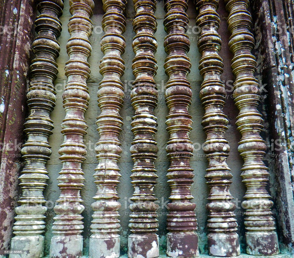 Traditional Stone Carving of Several Spindles Angkor Thom Cambodia stock photo