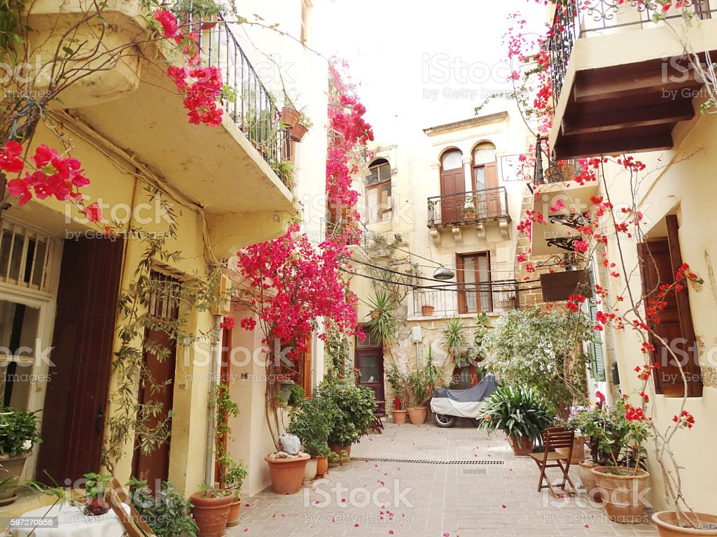 traditional street among bougainvillaea in rethymno city Greece Lizenzfreies stock-foto