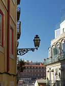 A beautiful vertical photo of a Traditional Street lamp in Lisbon with the sun light of the morning