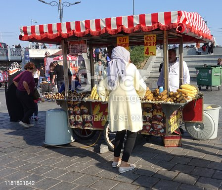Istanbul, Turkey - October 15, 2019: Street vendor selling boiled corn and roasted chestnuts in touristic Eminonu.