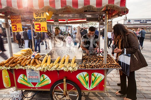 Istanbul, Turkey - May 9, 2018: Street vendor selling boiled corn and roasted chestnuts in touristic eminonu.