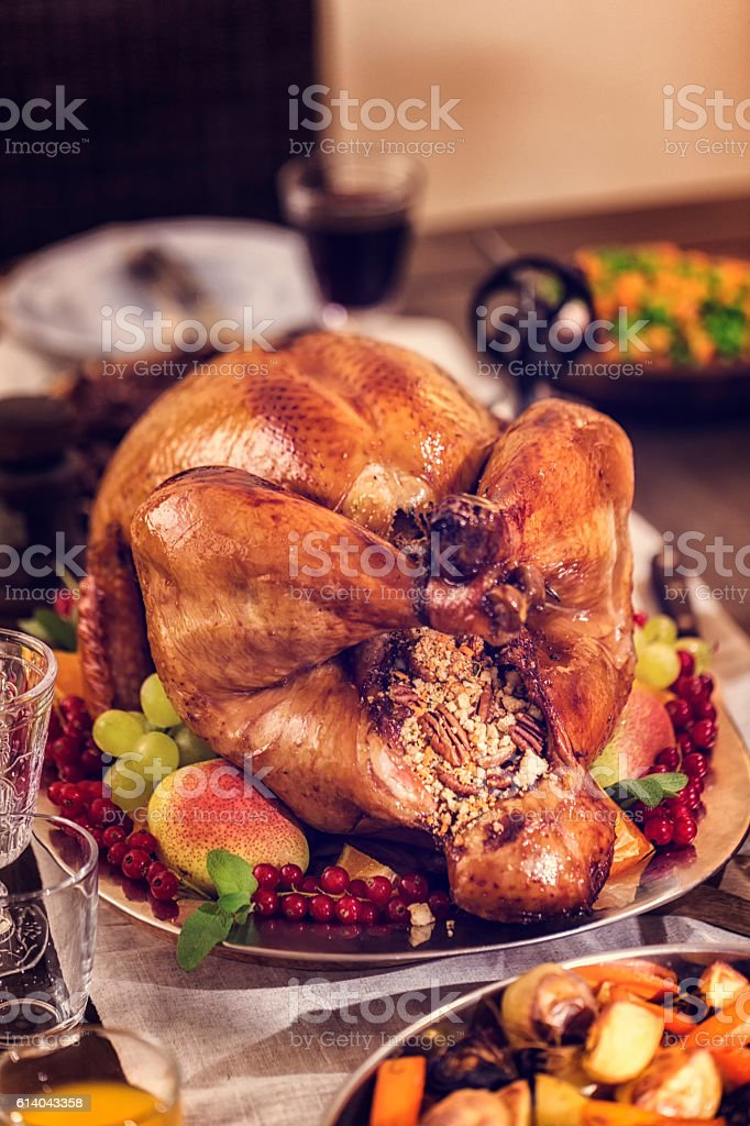Traditional holiday dinner with stuffed turkey, mashed potatoes,...