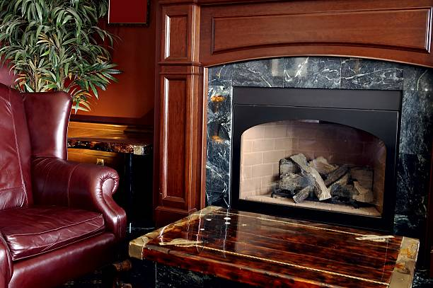 Traditional style living room with a fireplace stock photo