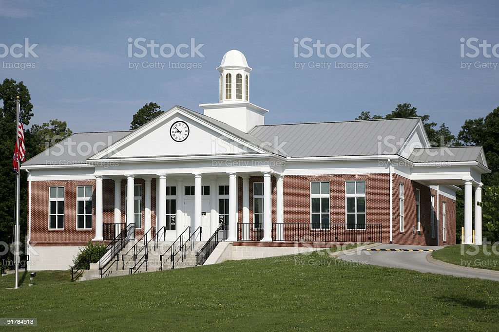 Traditional style small office building with drive-thru stock photo