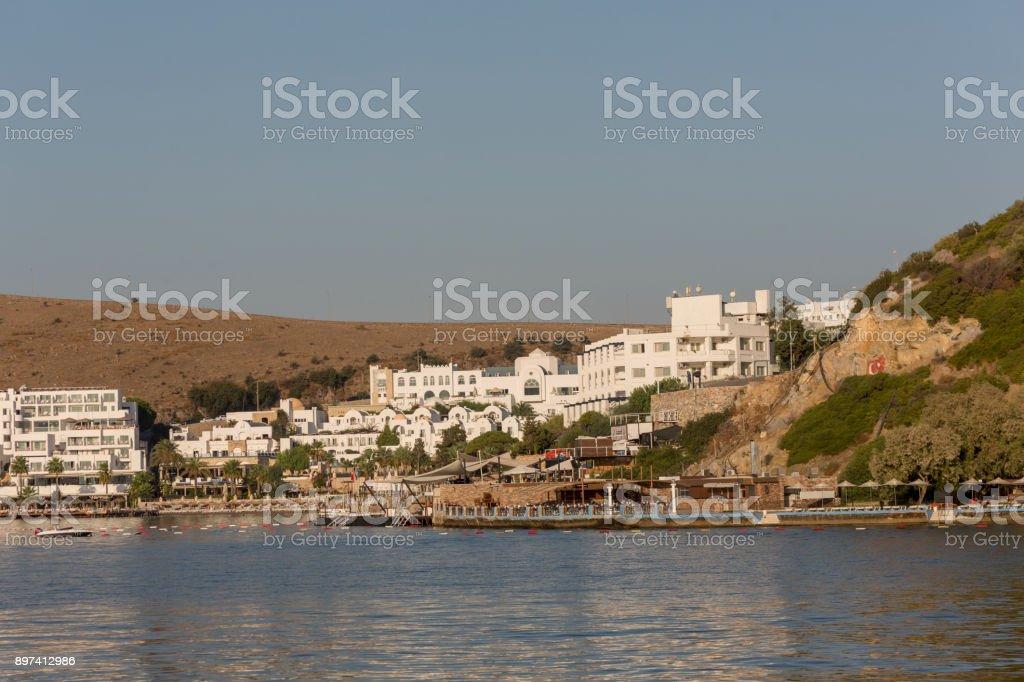 Traditional summer houses and hotel at coast of gokova bay aegean sea near bodrum turkey stock photo