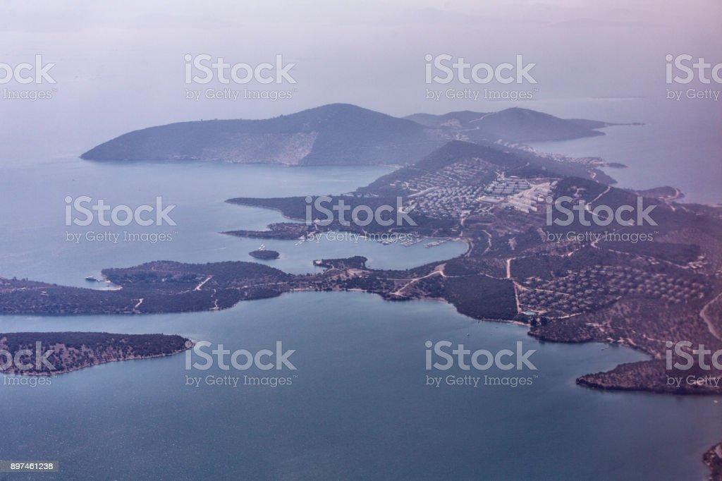 Traditional summer houses at coast of gokova bay aegean sea near bodrum turkey stock photo