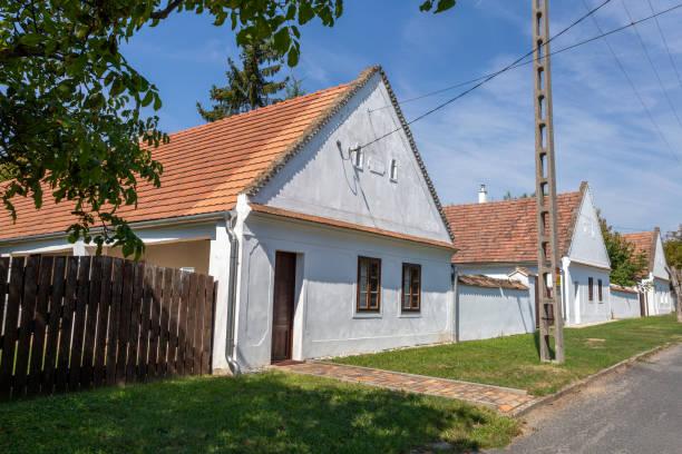 Traditional Swabian houses in Magyarpolany, Hungary. stock photo