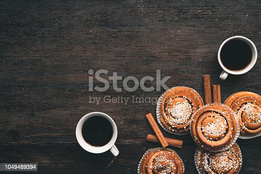 istock Traditional Swedish cinnamon bun on a wooden table 1049489394