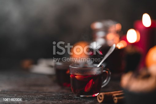 The traditional Swedish mulled wine drink known as glögg, on a wooden table at Christmas.