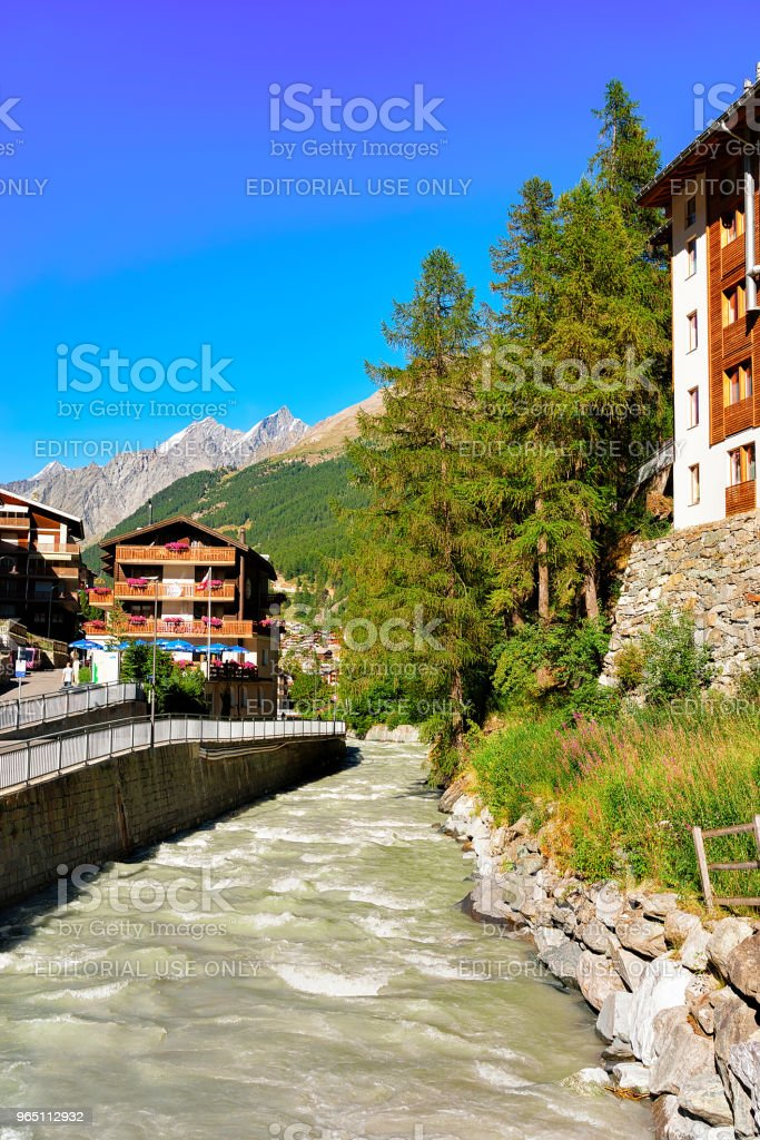 Traditional Swiss chalets and Gornera River resort town Zermatt zbiór zdjęć royalty-free