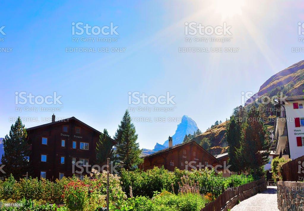 Traditional Swiss Chalets in Zermatt and Matterhorn summit CH royalty-free stock photo