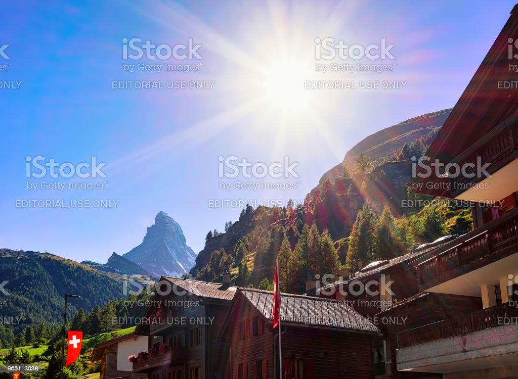 Traditional Swiss Chalets in Zermatt with Matterhorn summit CH flags royalty-free stock photo