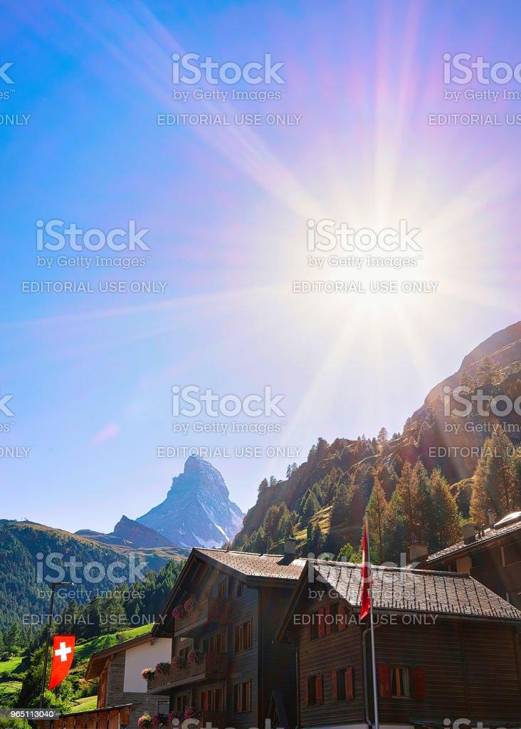 Traditional Swiss Chalets in Zermatt with Matterhorn summit flag CH zbiór zdjęć royalty-free