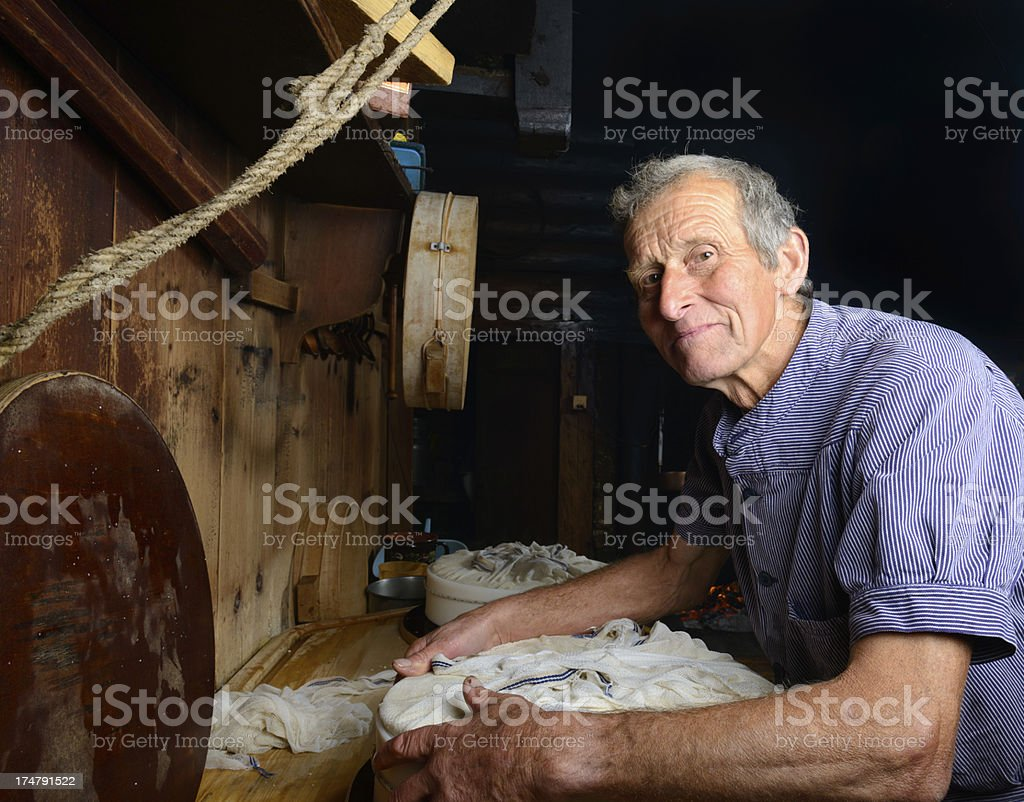 Traditional Swiss cheese making stock photo