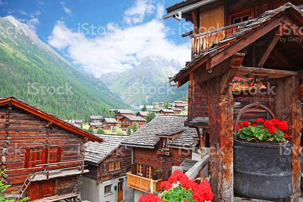 Traditional Swiss Mountain Chalets in Grimentz Village in Summer stock photo