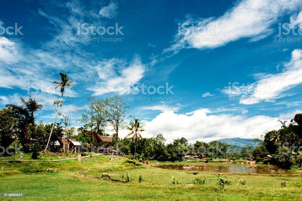 Traditional Tana Toraja village, tongkonan houses and buildings. Sunny, blue sky with clouds. Kete Kesu, Rantepao, Sulawesi, Indonesia stock photo