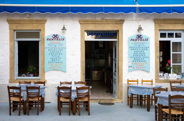 Traditional tavern in the chora of Patmos island stock photo