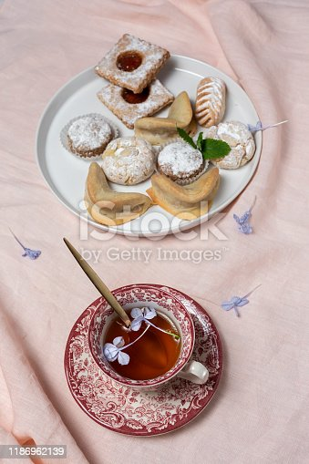 1189561410 istock photo Traditional tea with mint and assorted Arab sweets 1186962139