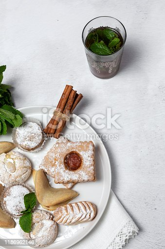 1189561410 istock photo Traditional tea with mint and assorted Arab sweets 1186962146