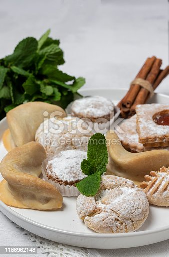 1189561410 istock photo Traditional tea with mint and assorted Arab sweets 1186962148