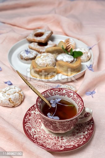 1189561410 istock photo Traditional tea with mint and assorted Arab sweets 1186962150