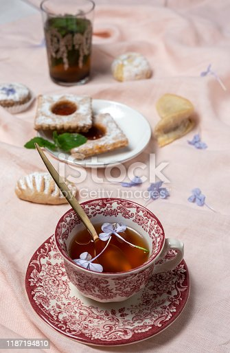 1189561410 istock photo Traditional tea with mint and assorted Arab sweets 1187194810