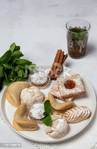 1189561410 istock photo Traditional tea with mint and assorted Arab sweets 1187195579