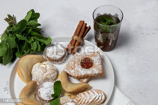 1189561410 istock photo Traditional tea with mint and assorted Arab sweets 1187202034