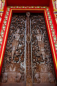 Native ancient Thai art in the Royal buddhist temple close up