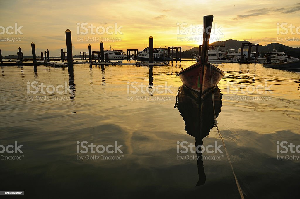 traditional Thai boat in twilight royalty-free stock photo