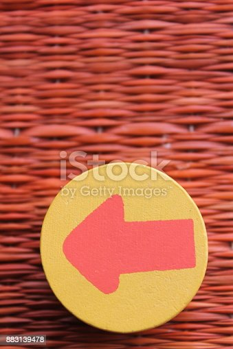 istock Traditional thai style nature background of brown handicraft weave texture wicker surface for furniture material with red arrow in yellow circle 883139478