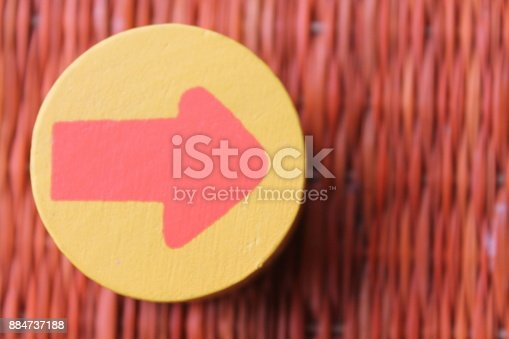 istock Traditional thai style nature background of brown handicraft weave texture wicker surface for furniture material with red arrow in yellow circle 884737188