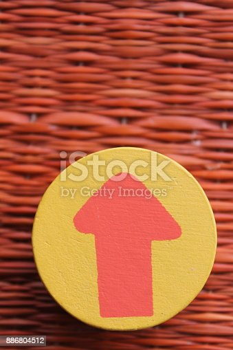 istock Traditional thai style nature background of brown handicraft weave texture wicker surface for furniture material with red arrow in yellow circle 886804512