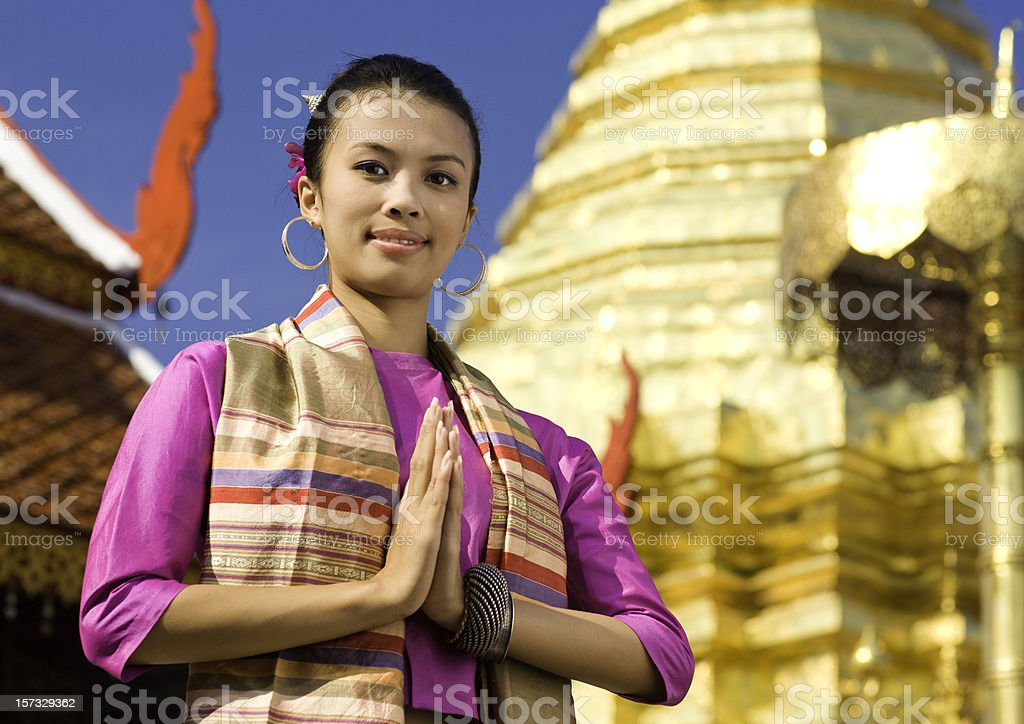 Traditional Thai Woman at a Buddhist Temple stock photo