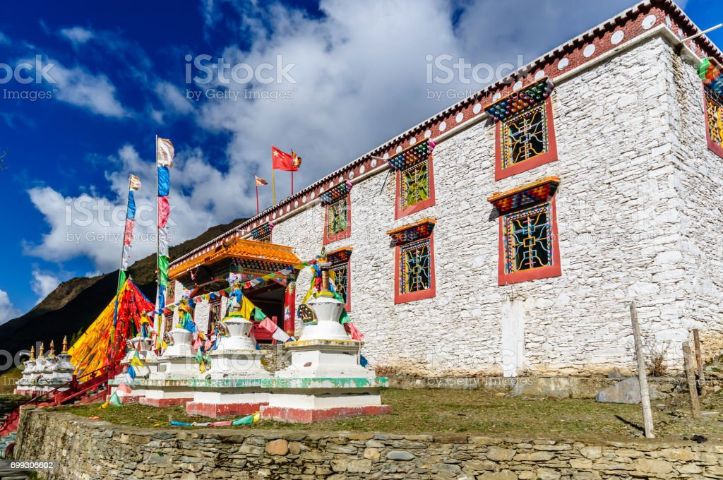 Traditional tibetan house with prayer flags stock photo