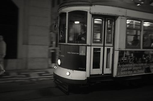 Lisbon, Portugal - November 21, 2015: A traditioal tram runs along a street  in Lisbon downtown at night.