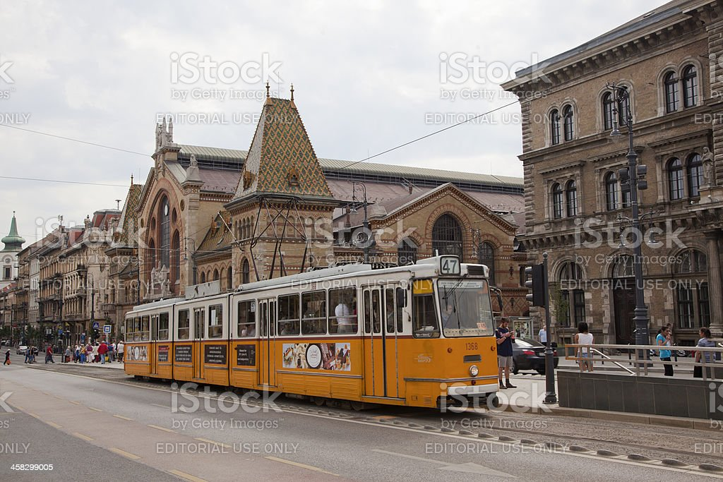 Traditional tram is passing by street at Budapest Hungary stock photo
