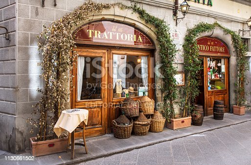 Florence, Italy - April 08, 2018: Traditional trattoria on narrow street in Florence, Tuscany Italy