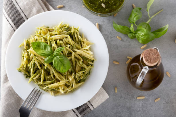 Traditional trofie pasta with pesto sauce on white plate stock photo