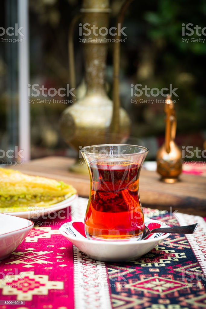 Traditional Turkish Azerbaijani black tea in pear shaped glass and saucer in national oriental style arrangement stock photo