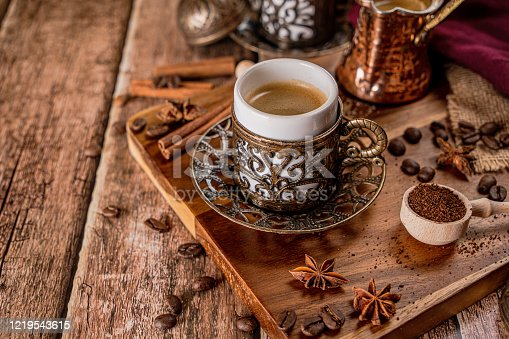 Traditional turkish coffee cup and roasted coffee beans