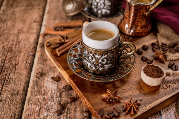 Traditional turkish coffee cup and roasted coffee beans stock photo
