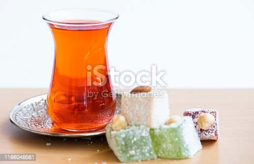 Traditional turkish delight and cup of tea.